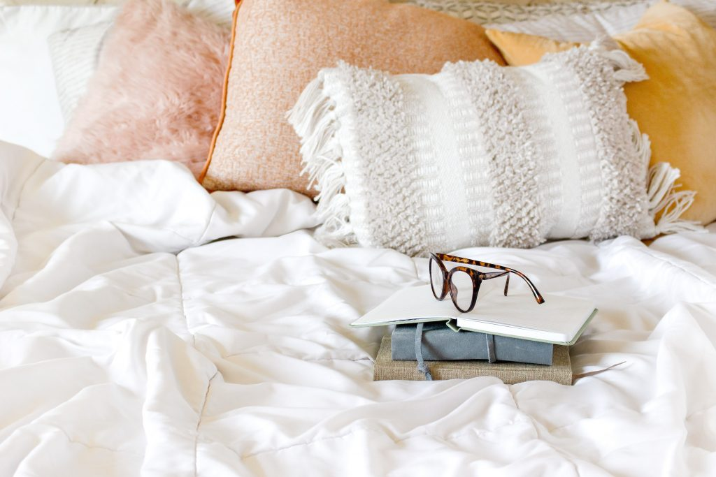 Bed with Book and Glasses, pillows